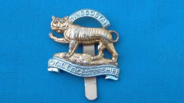 The Leicestershire Regiment cap badge.
