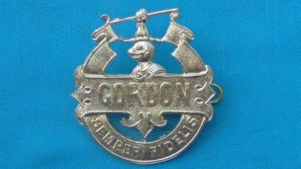 The Gordon School Officer Training Corp cap badge.