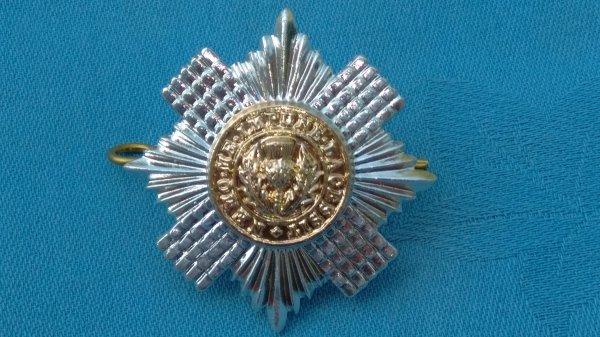 The Scots Guards Sergeants cap badge.