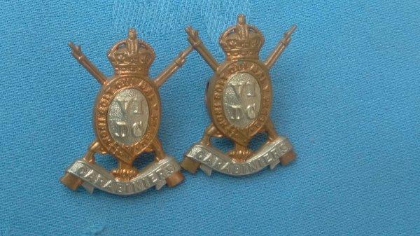 The 6th Dragoon Guards ( Carabiniers ) collar badges.