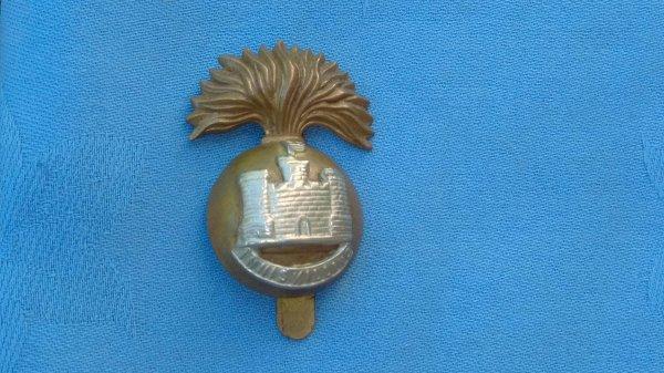 The Royal Inniskilling Fusiliers cap badge.