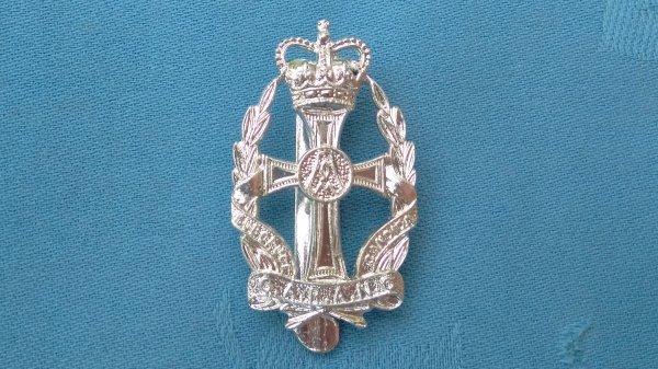 The Queens Royal Alexandra Nursing Corp cap badge.