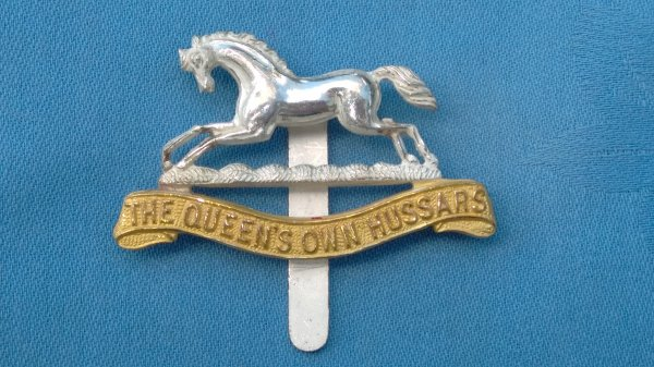 The Queens own Hussars Officers cap badge.