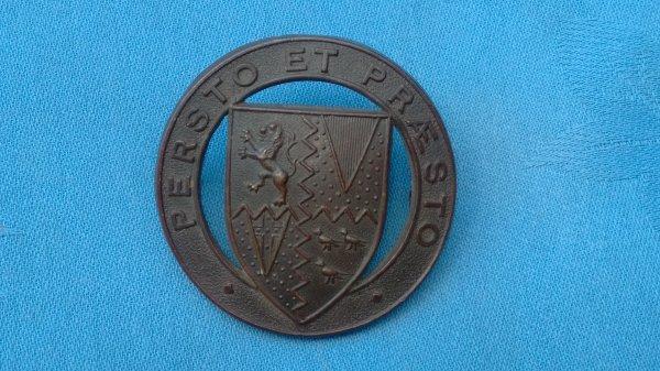 The Stowe School Bucks Officer Training Corp cap badge.