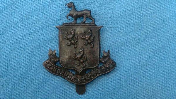 The Cranbrook School Officer Training Corp cap badge.