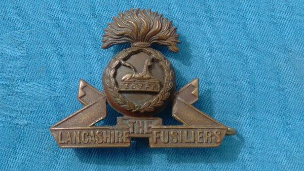 The Lancashire Fusiliers Officers cap badge.