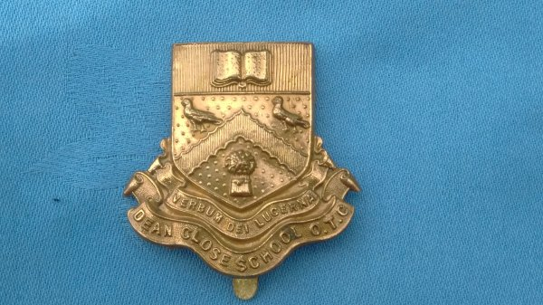 The Dean Close School Officer Training Corp cap badge.