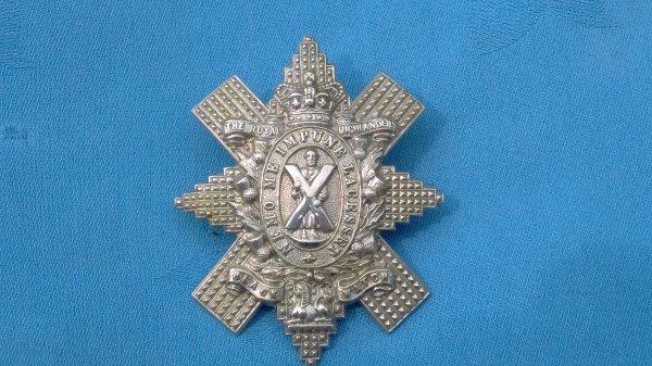 QVC.The Royal Highlanders Black Watch cap badge.