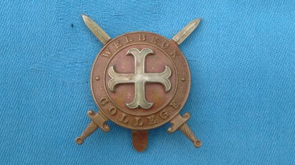 The Welbeck College Officer Training Corp cap badge.