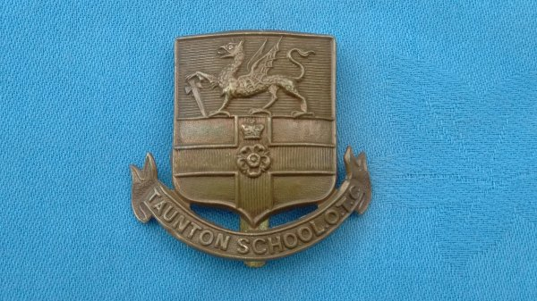 The Taunton School Officer Training Corp cap badge.
