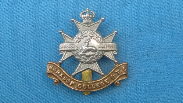 The Worksop College Officer Training Corp cap badge.