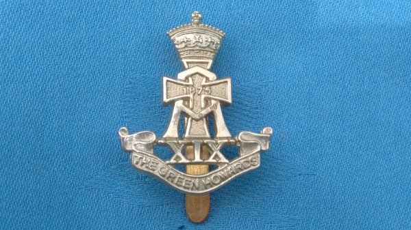 The Green Howards cap badge.