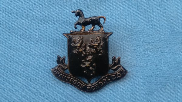 The Cranbrook School Officer Training Corp cap badge.