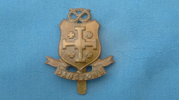 The Denstone College Officer Training Corp cap badge.
