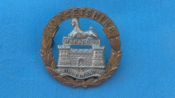 The Dorsetshire Regiment cap badge.
