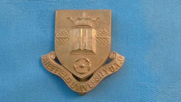 The Sheffield University Officer Training Corp cap badge.