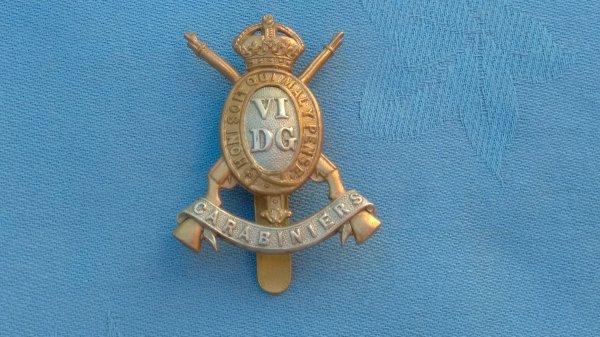 The 6th Dragoon Guards ( Carabiniers ) cap badge.