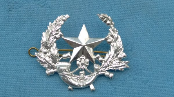 The Cameronions Scottish Rifles cap badge.