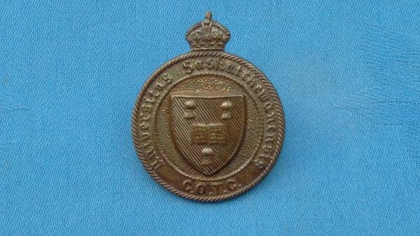 The Saskatchewan University Canadian Officer Training Corp cap badge.