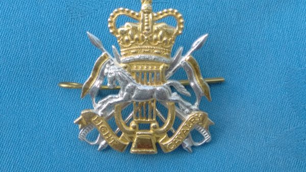 The Light Cavalry Band cap badge.