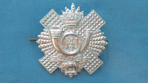 The Highland Light Infantry cap badge.