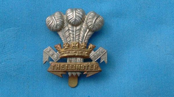 The Leinster Regiment ( Royal Canadians ) cap badge.