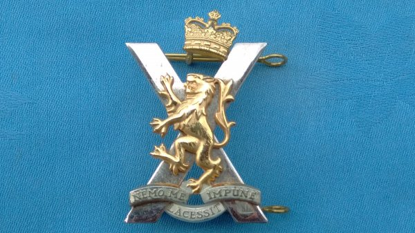 The Royal Regiment of Scotland Officers cap badge.