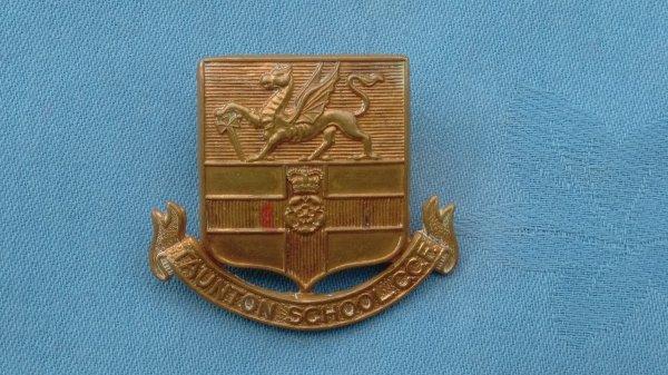 The Taunton School Somerset Combined Cadet Force cap badge.