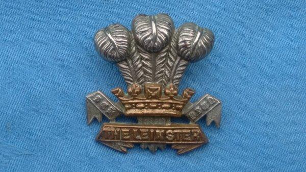 The Leinster Regiment cap badge.