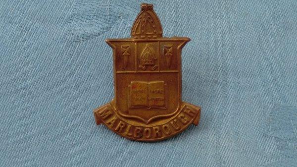 The Malborough College Wiltshire Officer Training Corp cap badge.
