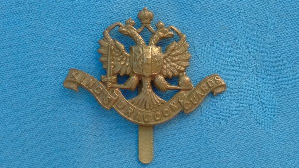 The 1st Kings Dragoon Guards cap badge.