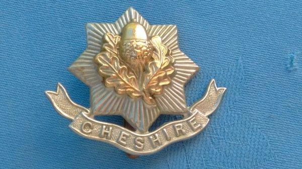 The Cheshire Regiment cap badge.