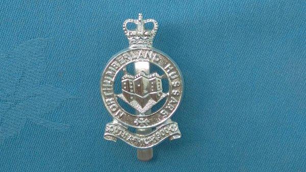 The Northumberland Hussars cap badge.
