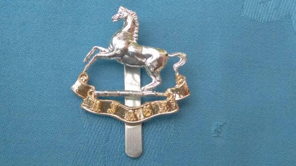 The Liverpool University Officer Training Corp cap badge.