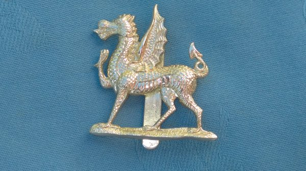 The Monmouthshire School Combined Cadet Force cap badge.