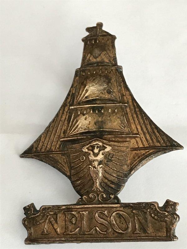 Genuine WW1 RND Nelson Cap Badge. JR Gaunt Tablet